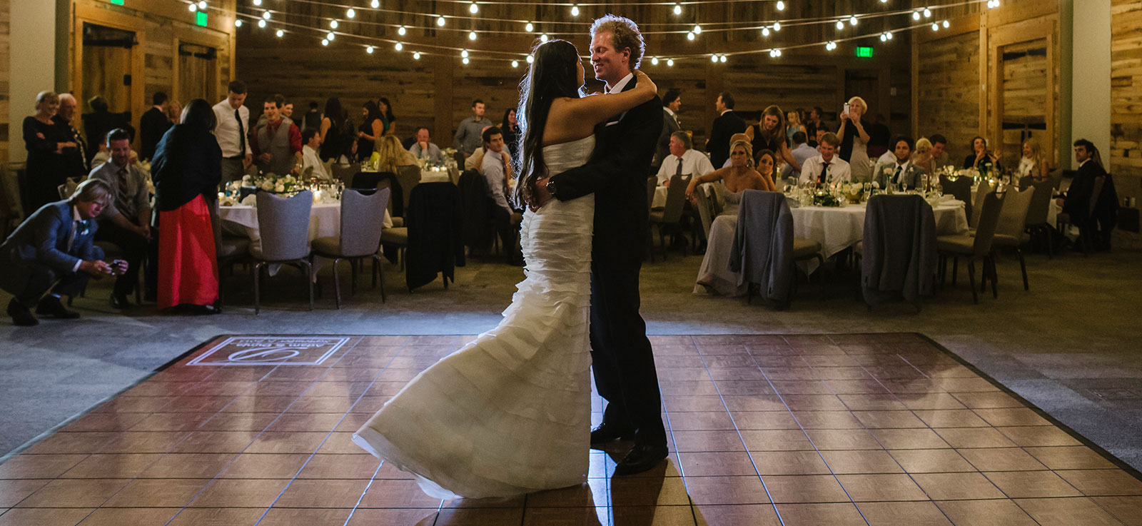 First dance at a wedding on a teak portable dance floor.