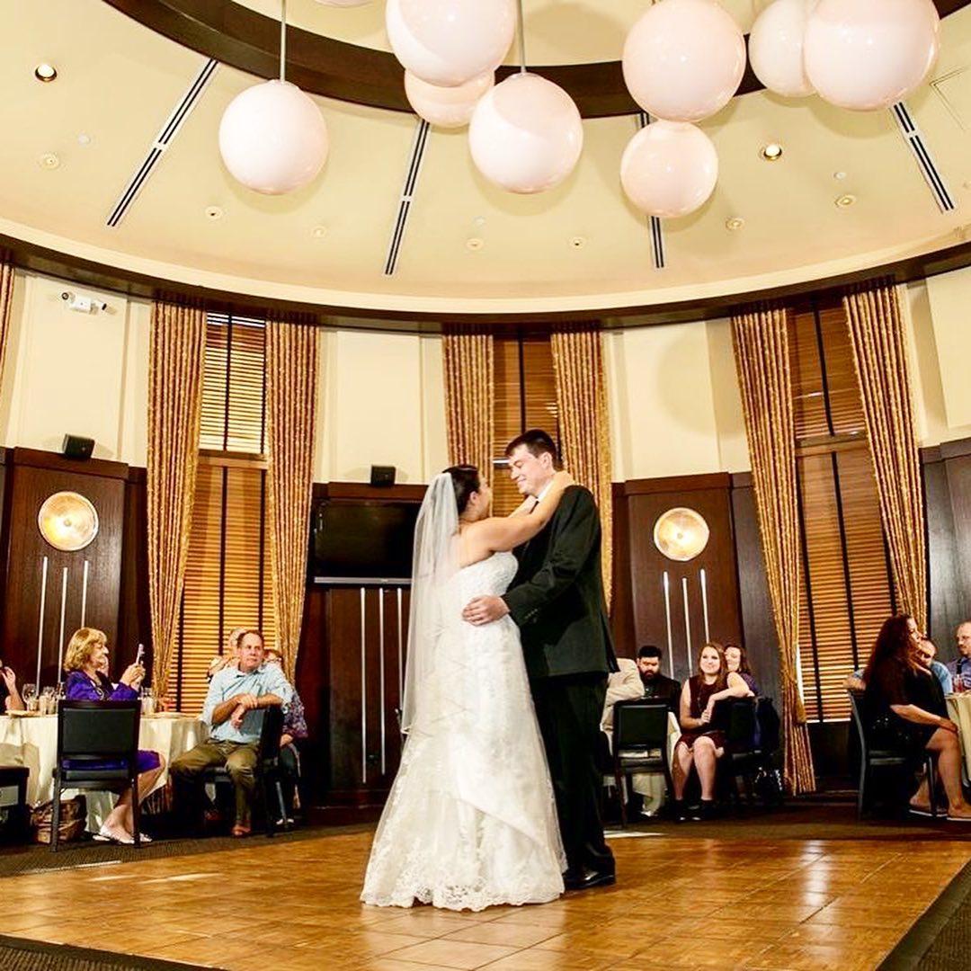 Happy couple dancing on our Teak style wedding dance floor.