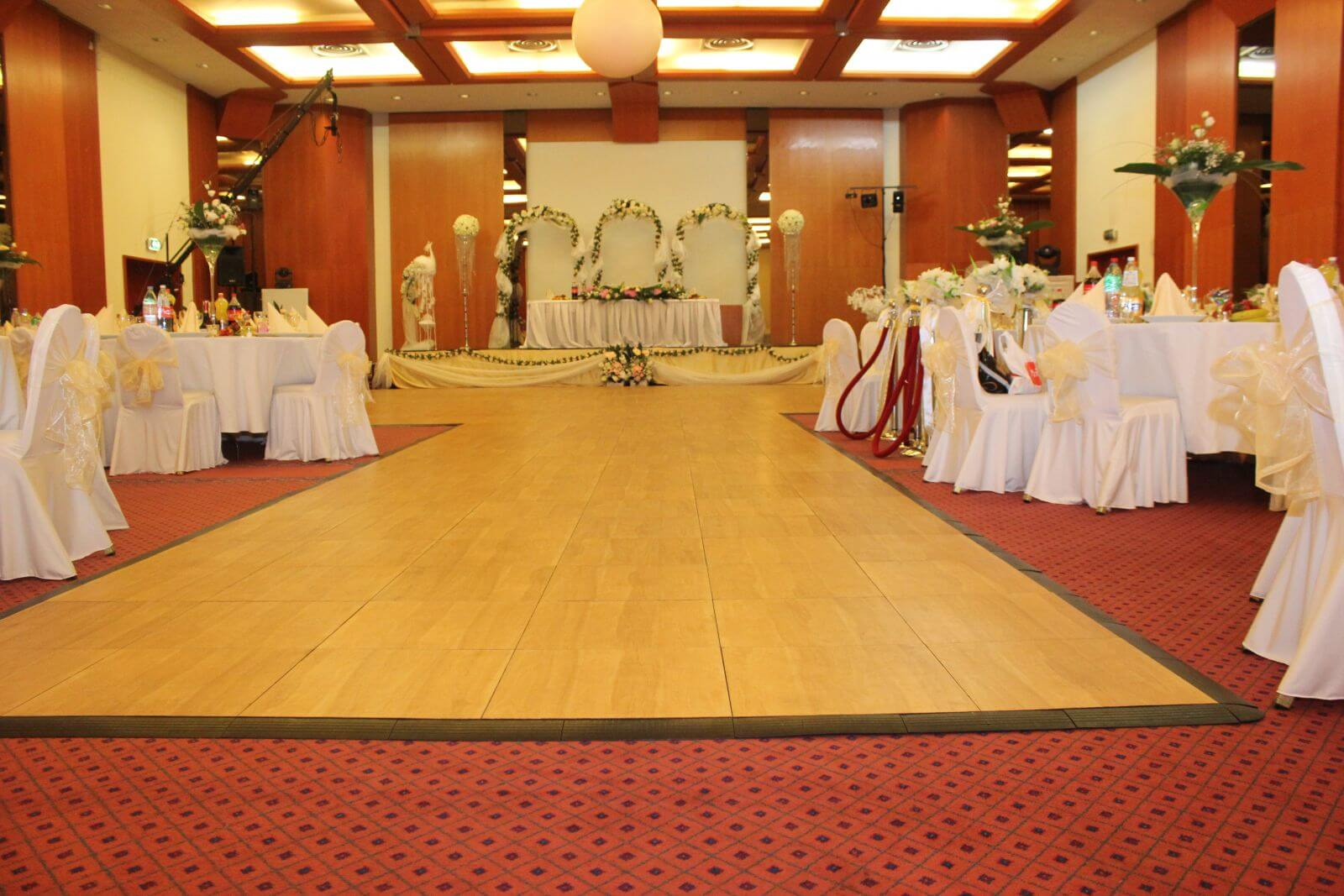 SnapLock Plus Maple style aisle and flooring at this indoor wedding venue