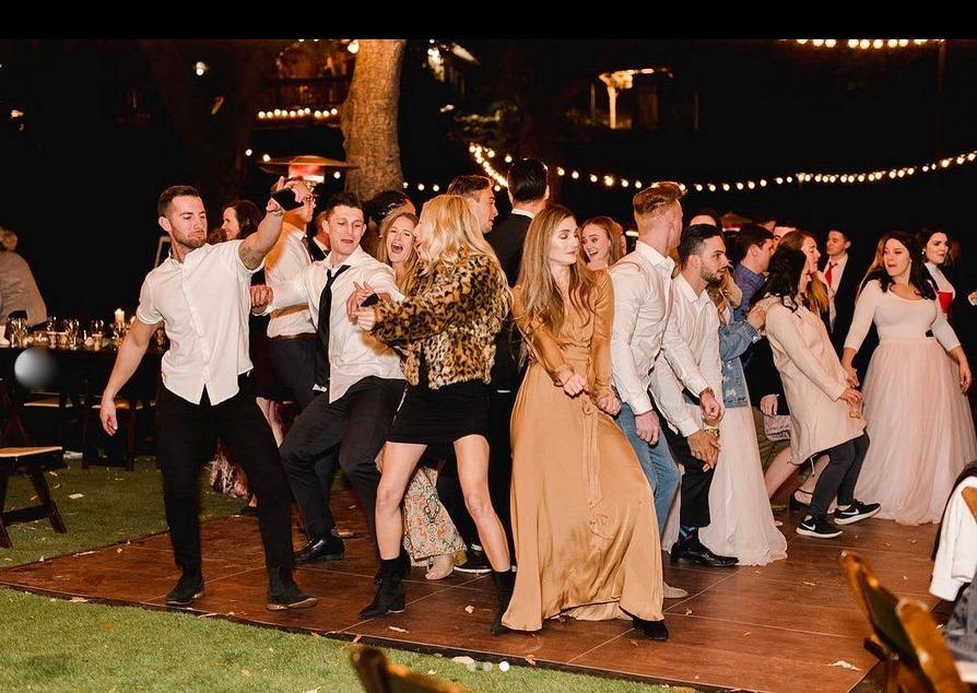 Having fun on the dance floor with SnapLock Plus Dark Maple flooring