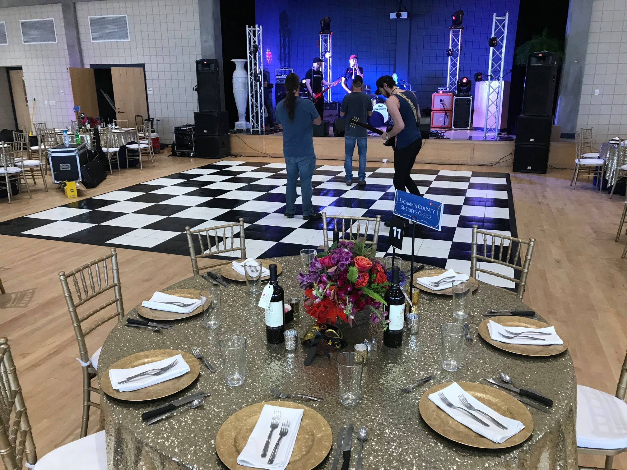 Black and White Slate style dance floor and band at this sparkling indoor event