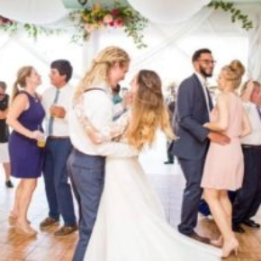 Couples dancing at a wedding on our Oak style dance flooring