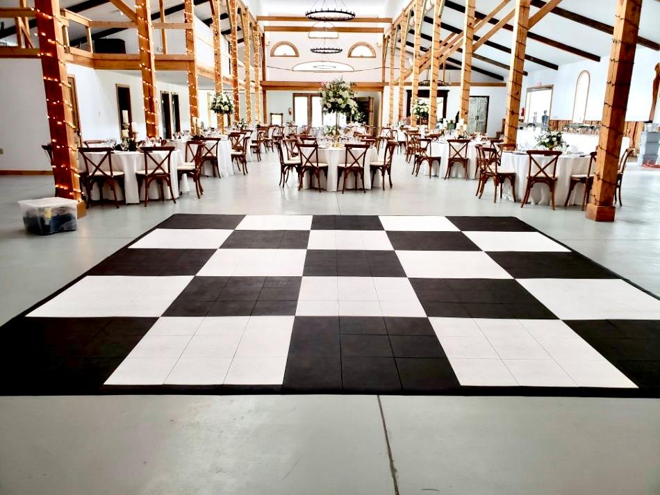 The Black and White Slate style checkered dance floor is a classic touch to this indoor venue.