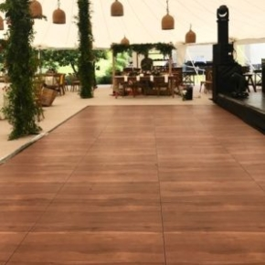 SnapLock Plus Dark Maple style dance floor at a tent event