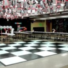 Checkered Slate Black and Slate White style dance floor at a festive indoor event