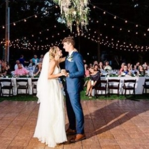 Teak style wedding dance floor beautifully complements the space.