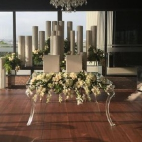 A Dark Maple dance floor is the perfect neutral stage for this beautiful wedding setup.