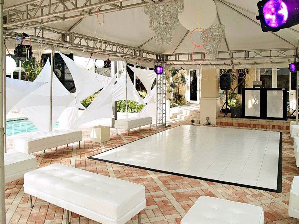 A slate white dance floor looks elegant in this airy event space.