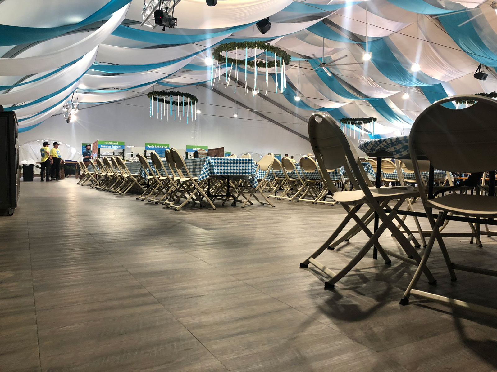 Chairs and tables set up on Smoked Oak flooring at Oktoberfest in Snowbird