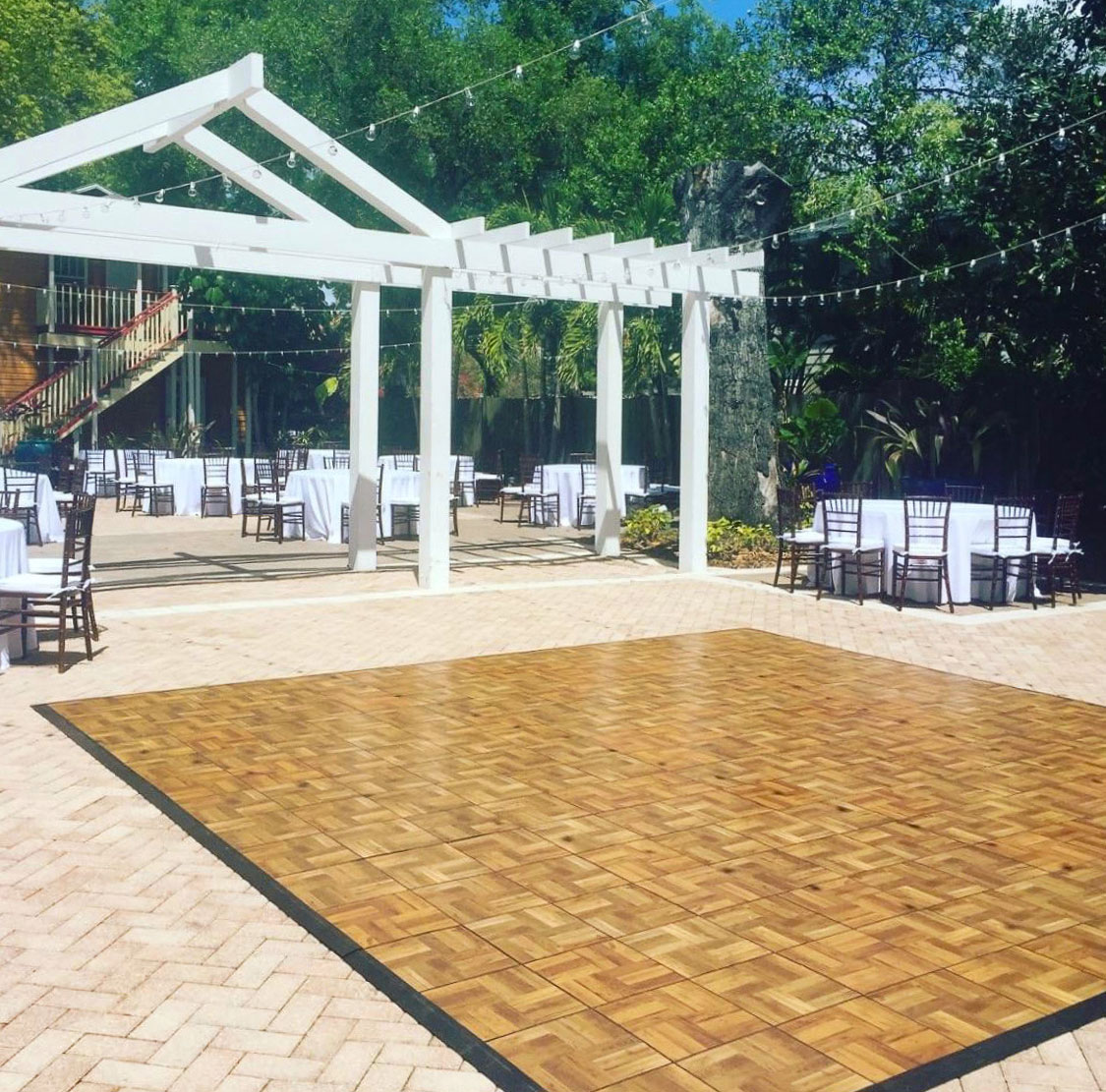 An oak-style dance floor is ready to welcome some dancing.