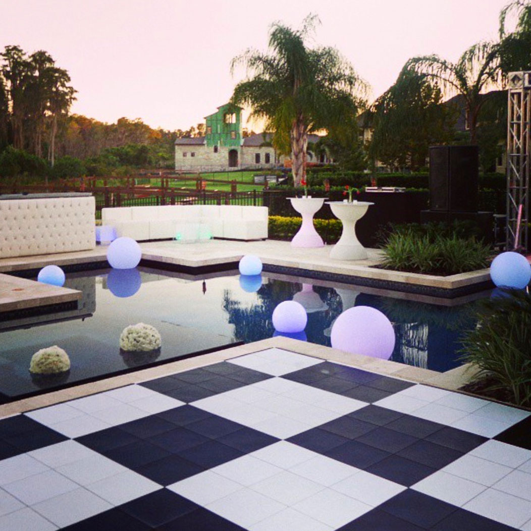 Checkered slate black and white dance floor by the poolside.
