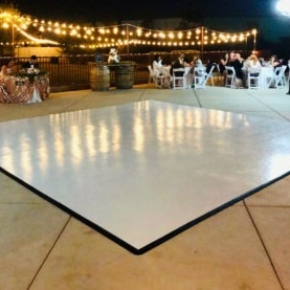 Slate White dance floor at a wedding during the nighttime