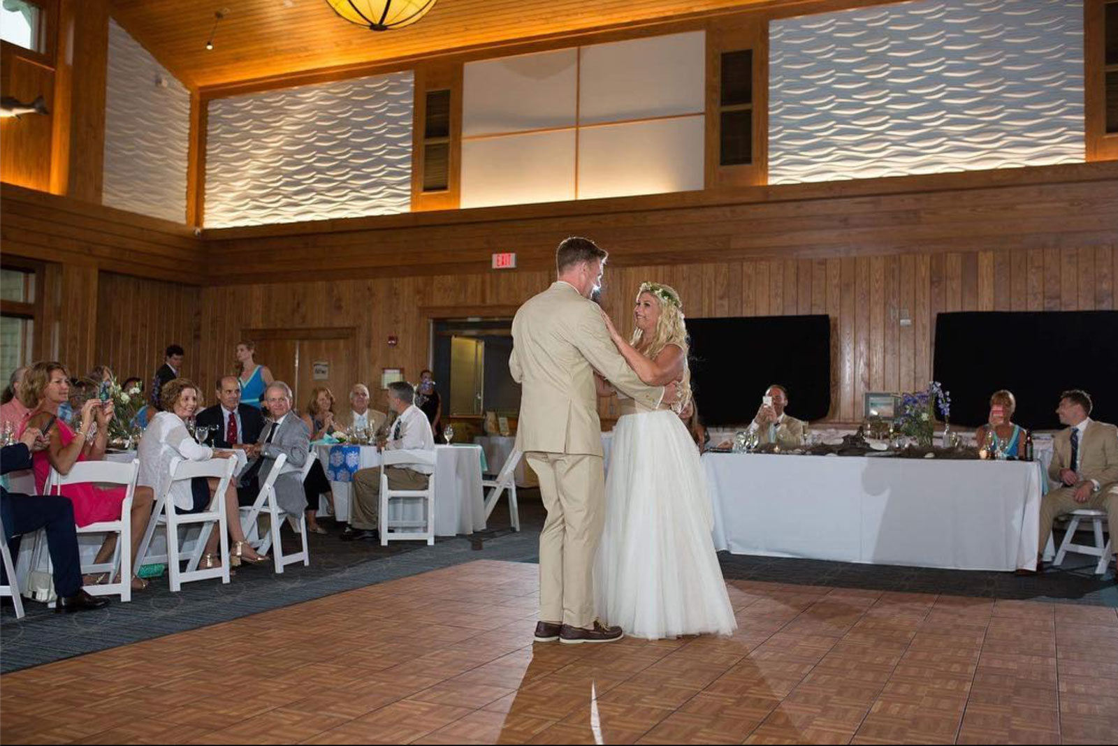 Oak style portable wedding dance floor inside a building