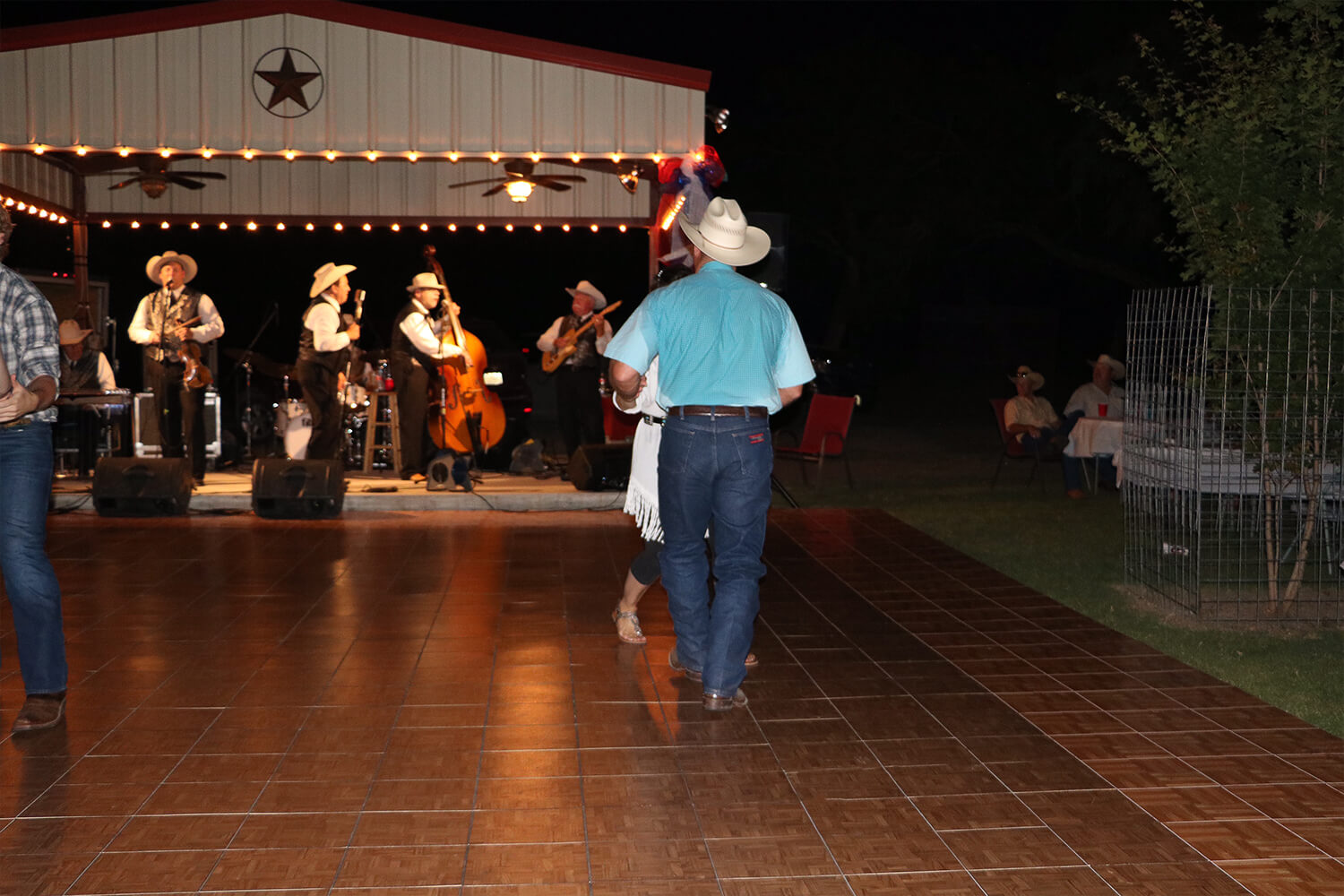 Teak dance floor with Oak border at this Western-themed dance event