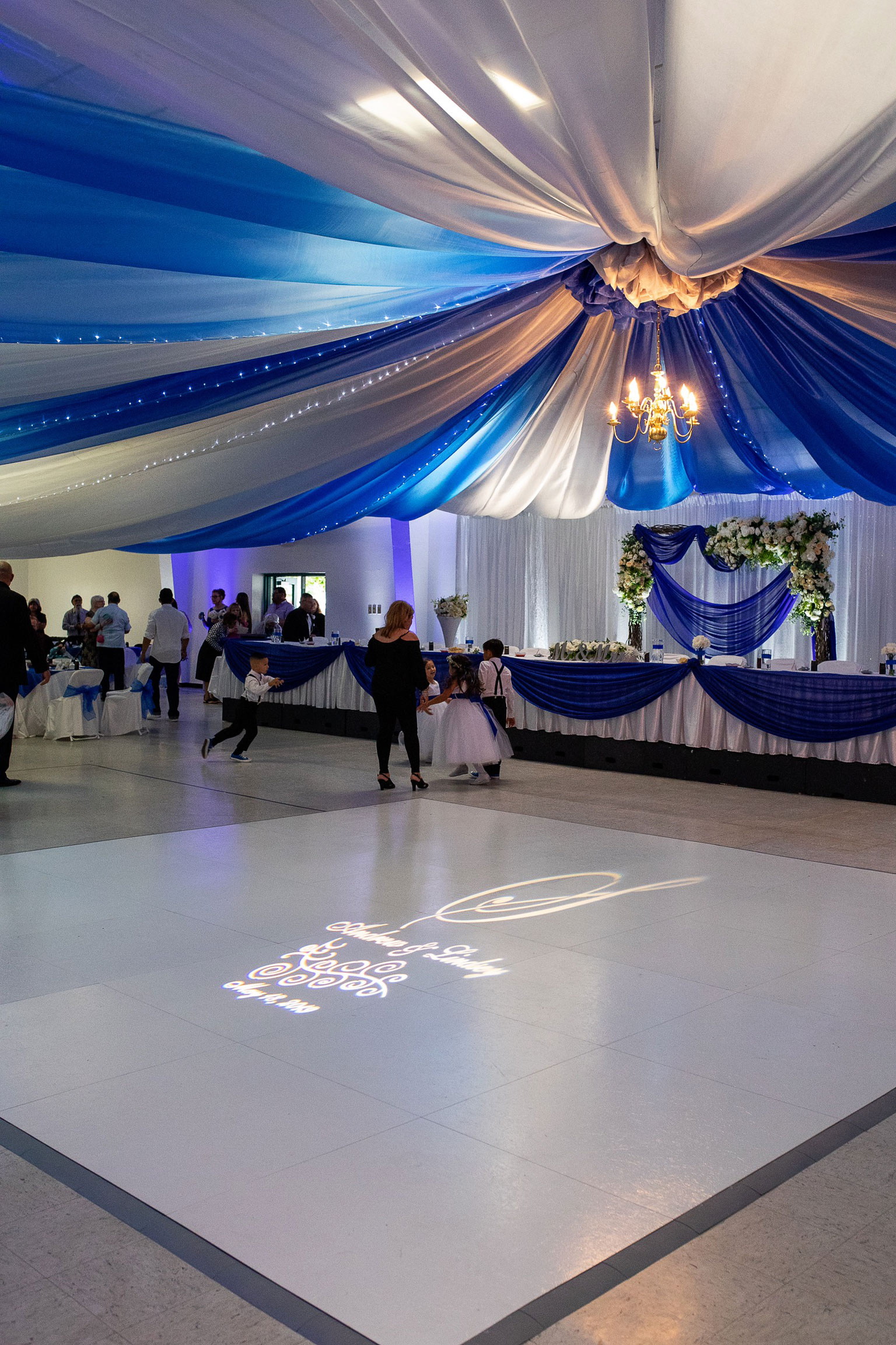 Slate White Plus wedding dance floor with projected design.