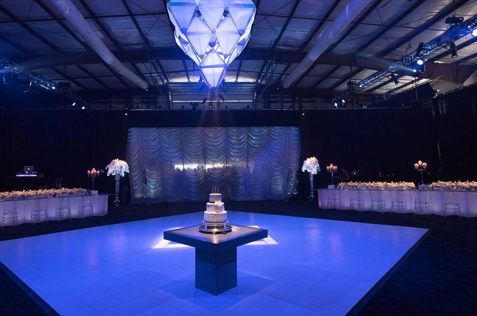 Slate White dance floor with edging in an elegant wedding event space