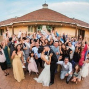 Drone photo of a happy couple and their guests on a Teak style wedding dance floor.