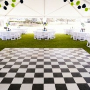 black and white slate checkerboard outside portable dance floor at wedding