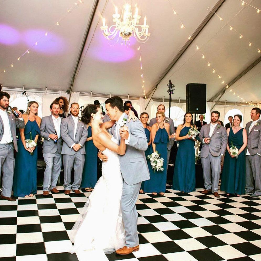 Black and white slate tiles are the base for this portable wedding setup.