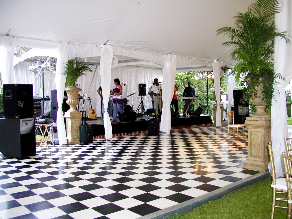 Checkerboard pattern dance floor with Slate Black and Slate White at a tent event with a live band