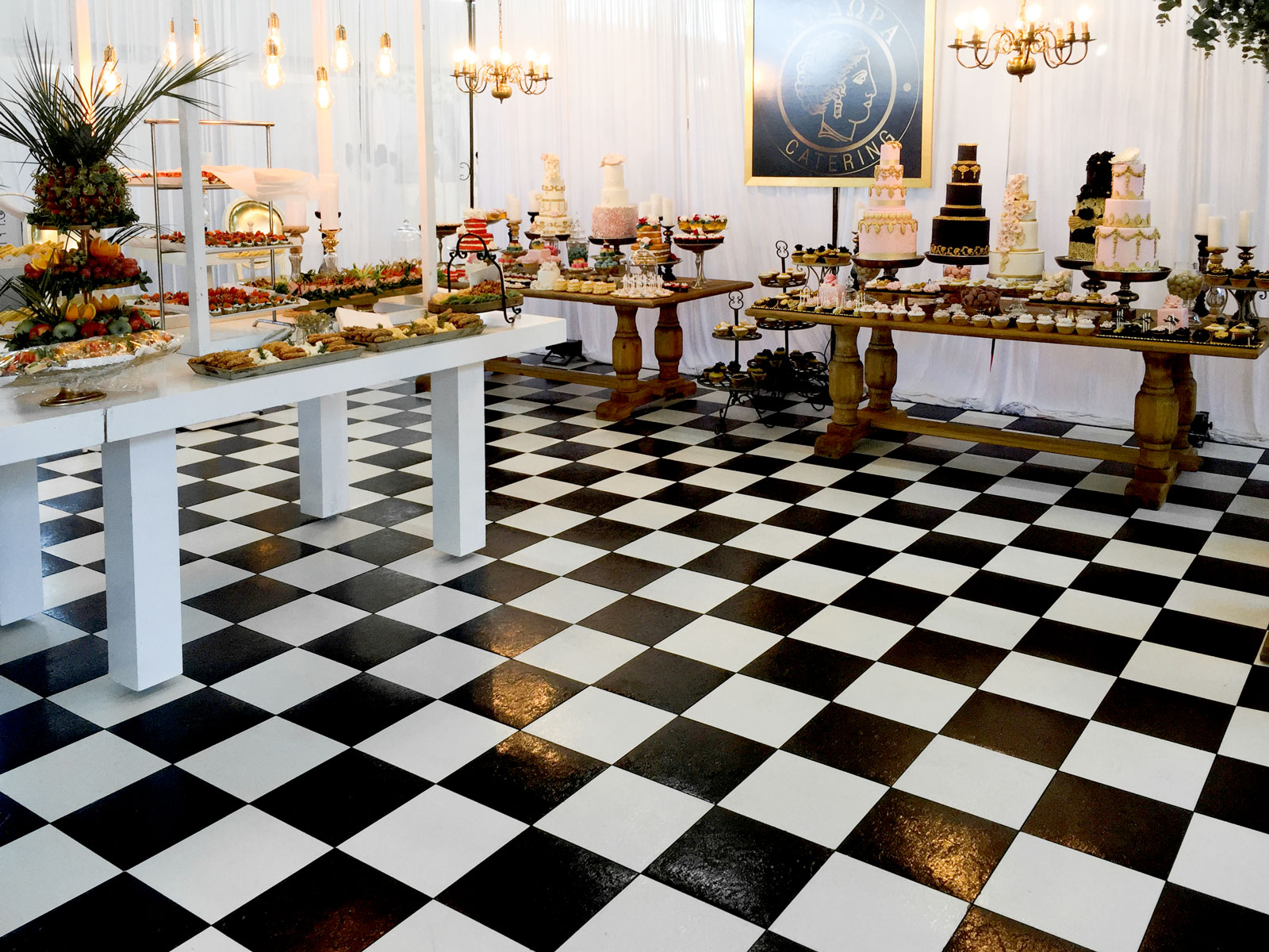 Wedding food tent floored with SnapLock's Slate Black and White dance flooring