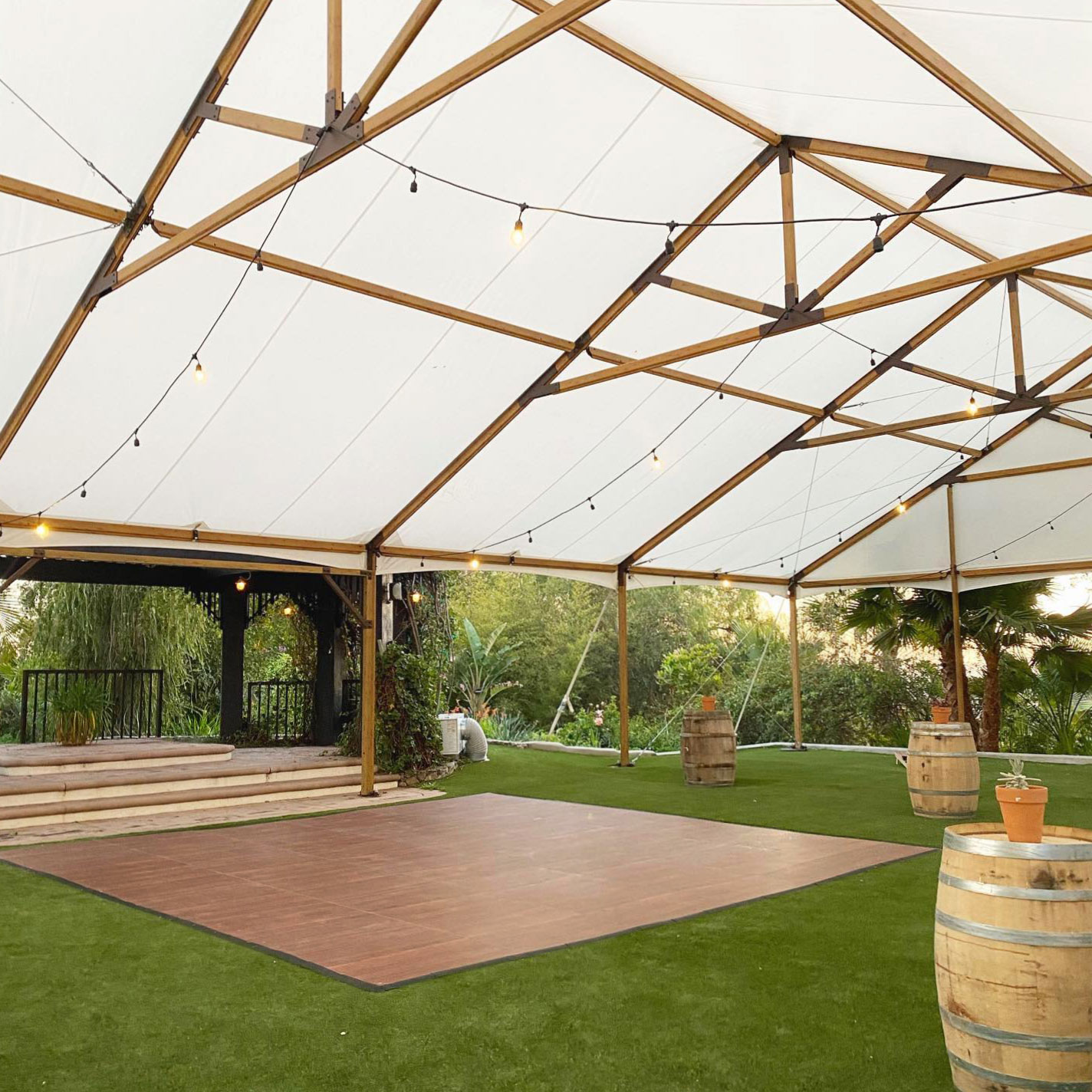 Dark Maple Plus dance floor under a tent, on grass