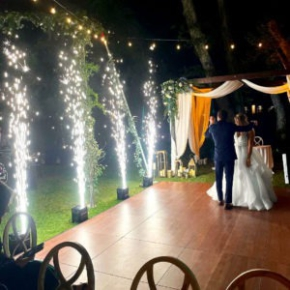 Sparks fly at this wedding with a Dark Maple Plus dance floor.