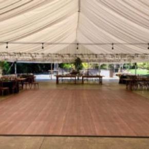 Dark Maple Plus dance floor at a wedding setup