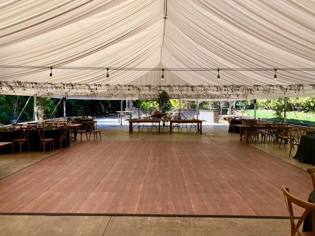Dark Maple Plus dance floor at a wedding setup