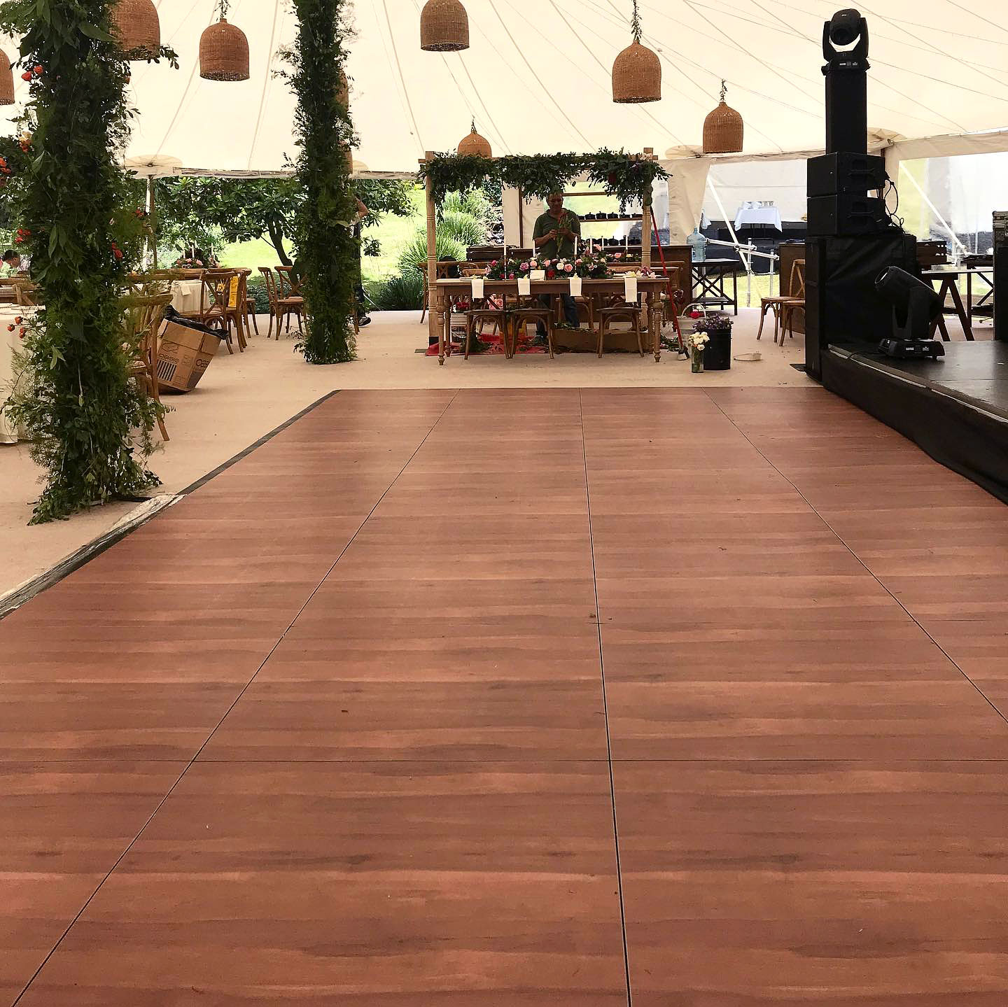 Dark Maple Plus dance floor in front of a stage at a tent event