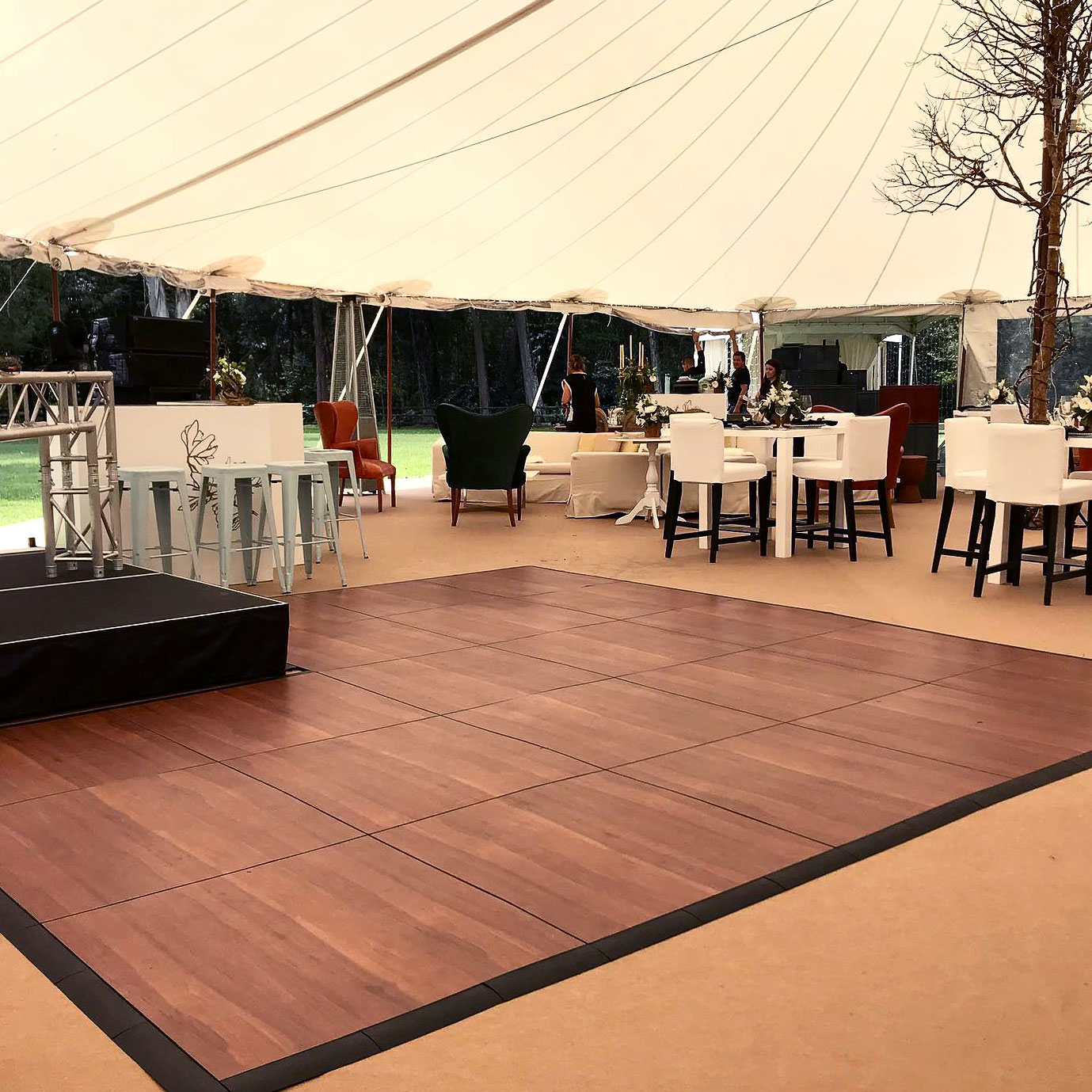 Dark Maple Plus dance floor with edges at a tent event