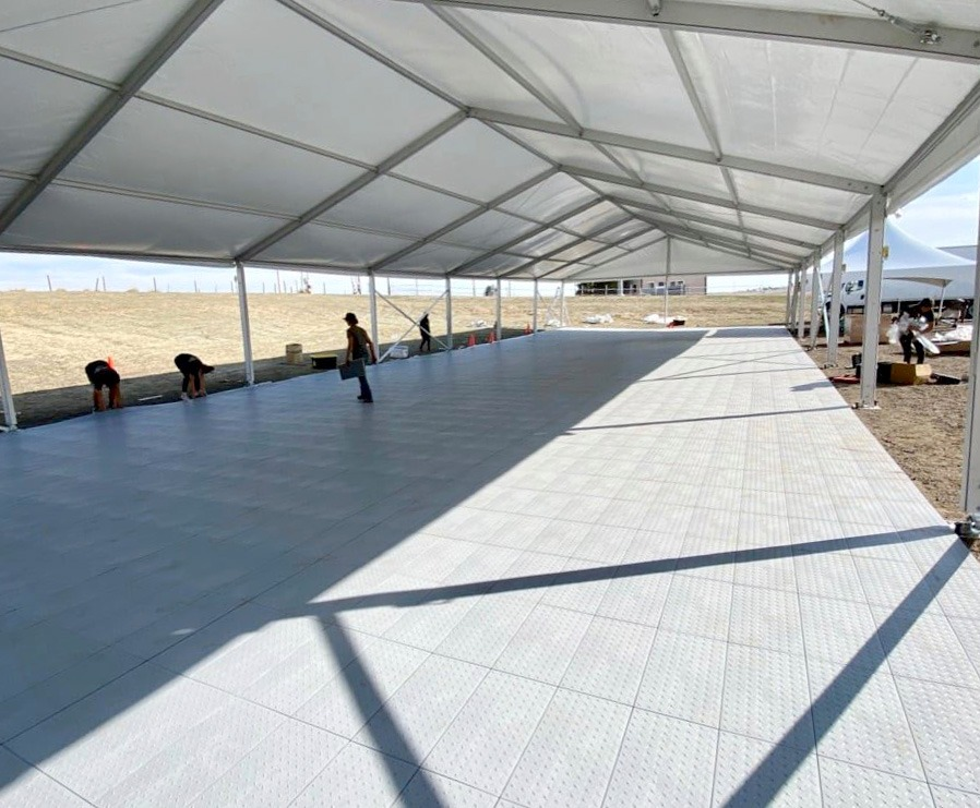 FastDeck event flooring under a large tent outdoors