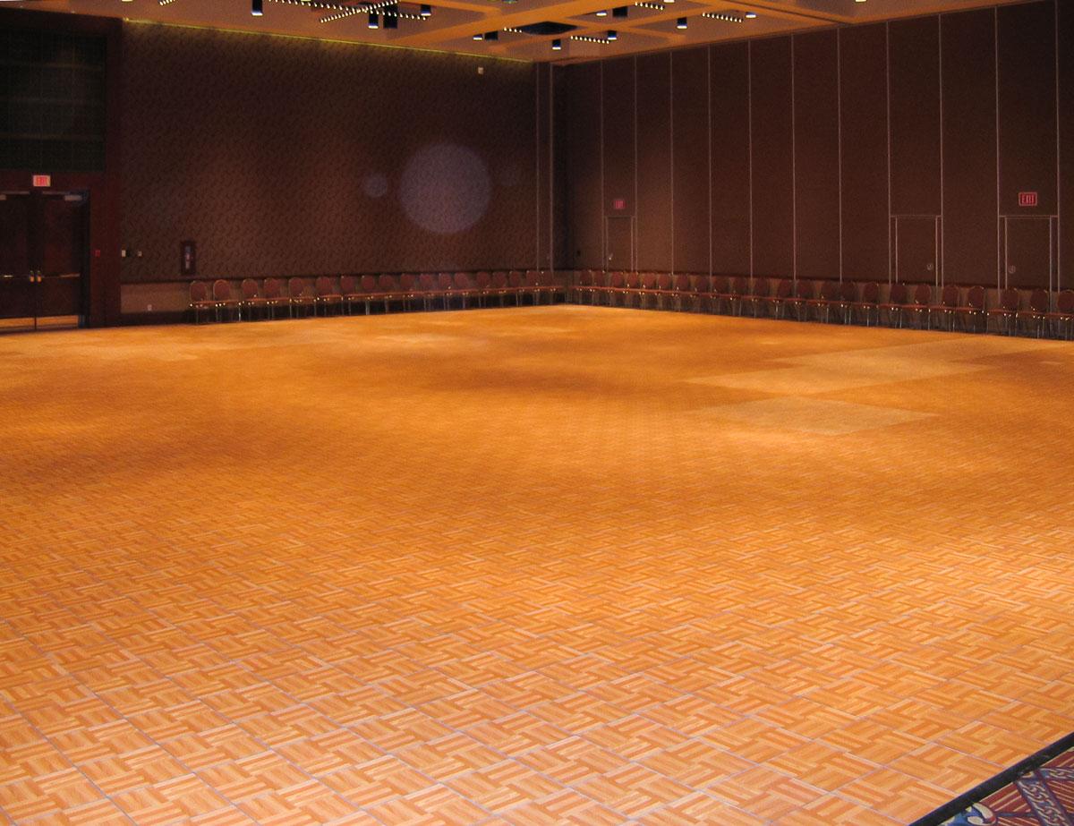 A large Oak Dance Floor in a hotel ballroom