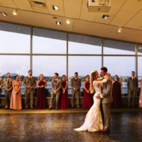 Couple dances on a Luxury Black Marble style dance floor under the spotlights