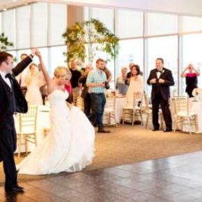 Black marble style dance floor at an indoor wedding venue