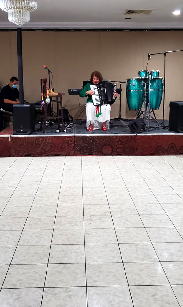 Musicians' stage in front of a Luxury White Marble style dance floor