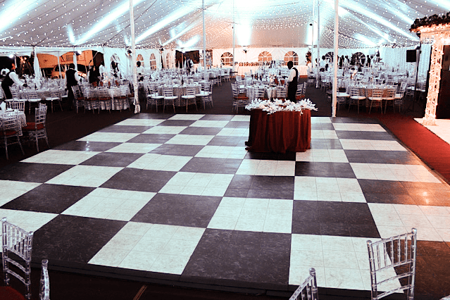 luxury black and white checkered flooring at large indoor wedding
