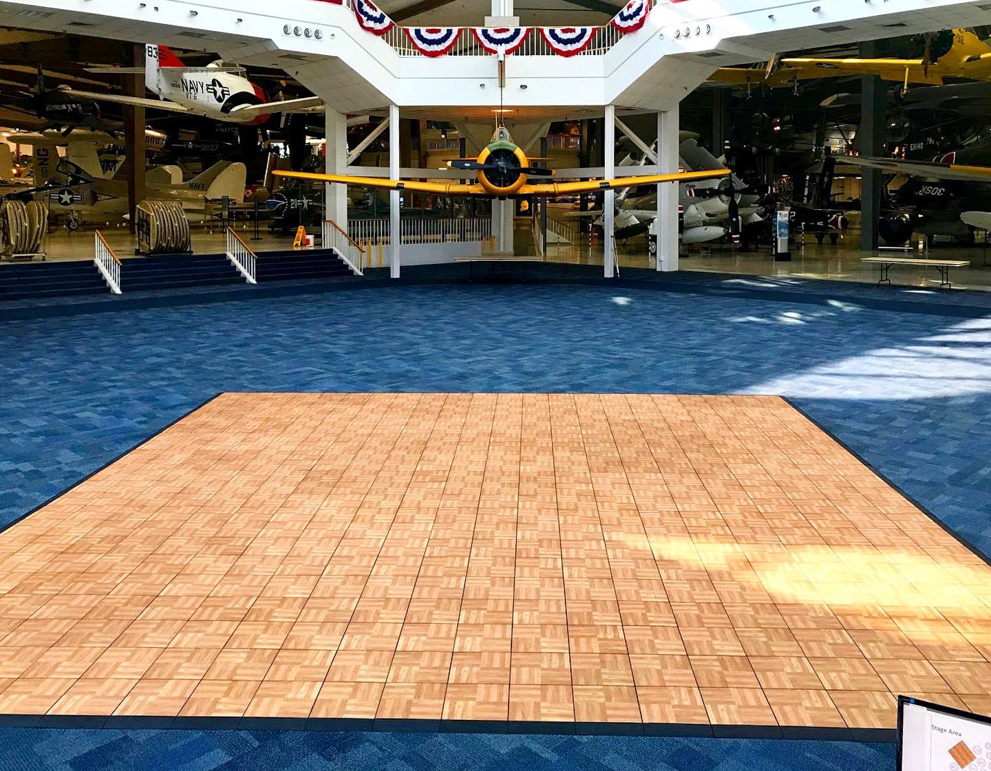 Oak style dance floor inside an airplane museum