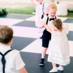 Kids dancing on a Slate Black and White Plus dance floor