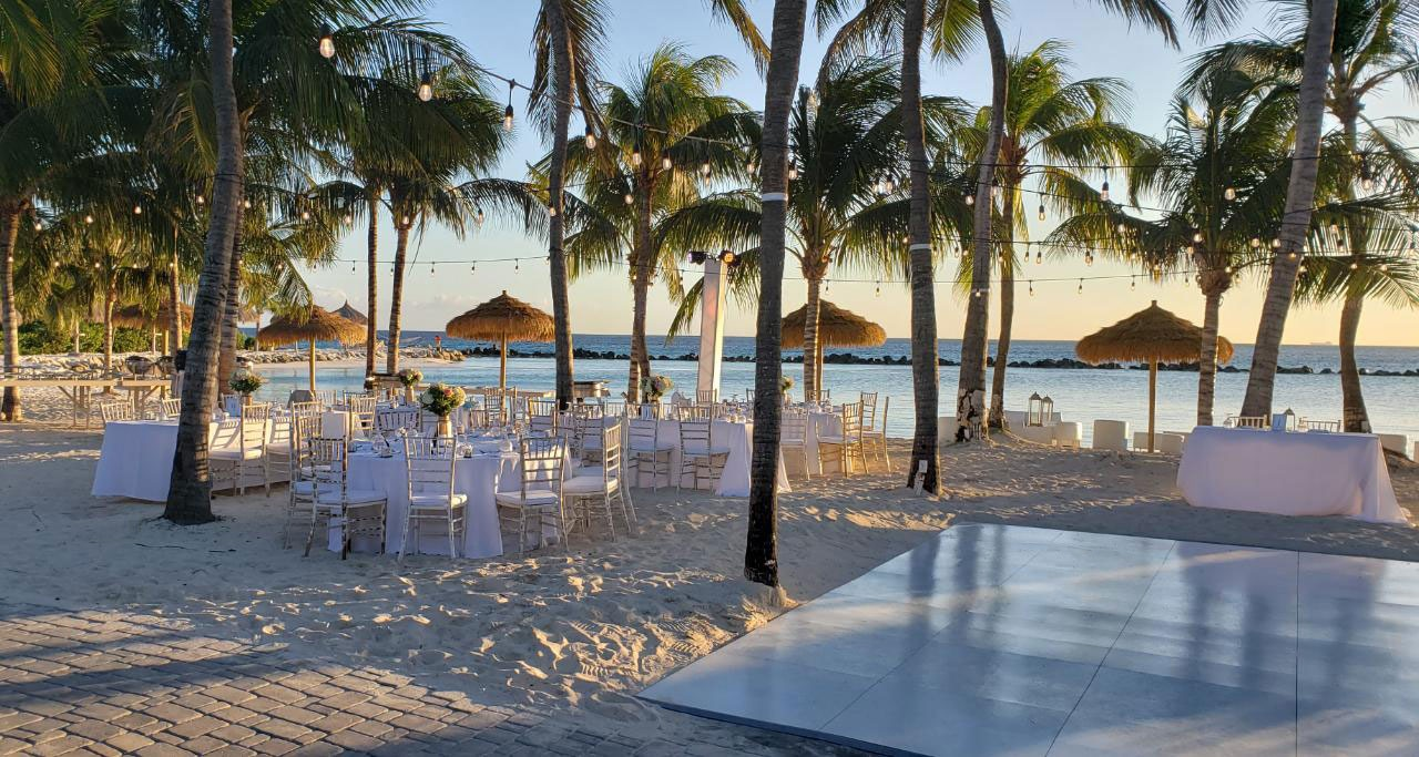Slate white style dance floor at a beach wedding
