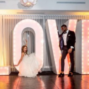"""Slate Black Plus dance floor with couple and a """"Love"""" sign"""