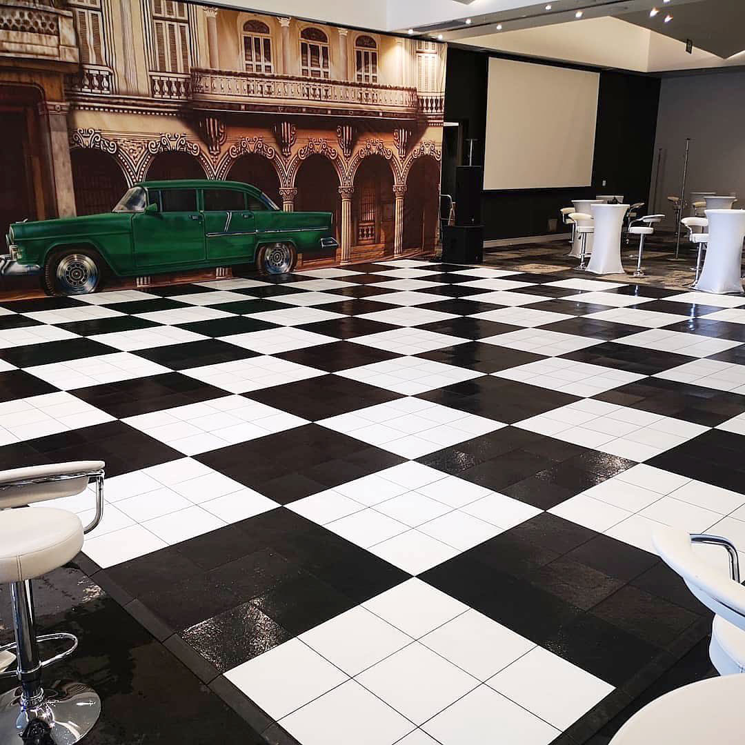 Large slate black and white checkered dance floor at event