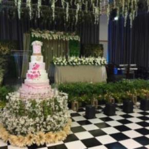 Wedding cake on checkered slate black and white dance floor
