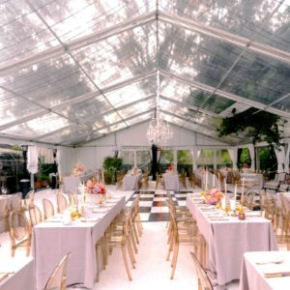 Slate black and white checkered dance floor in tent wedding space