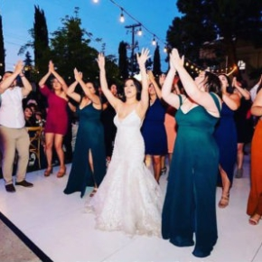 Wedding party dancing on a Slate White Plus style dance floor