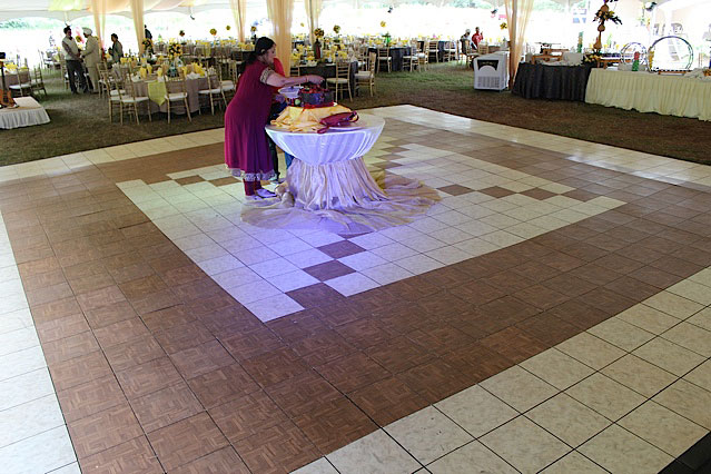Teak and slate white portable dance flooring at tent event
