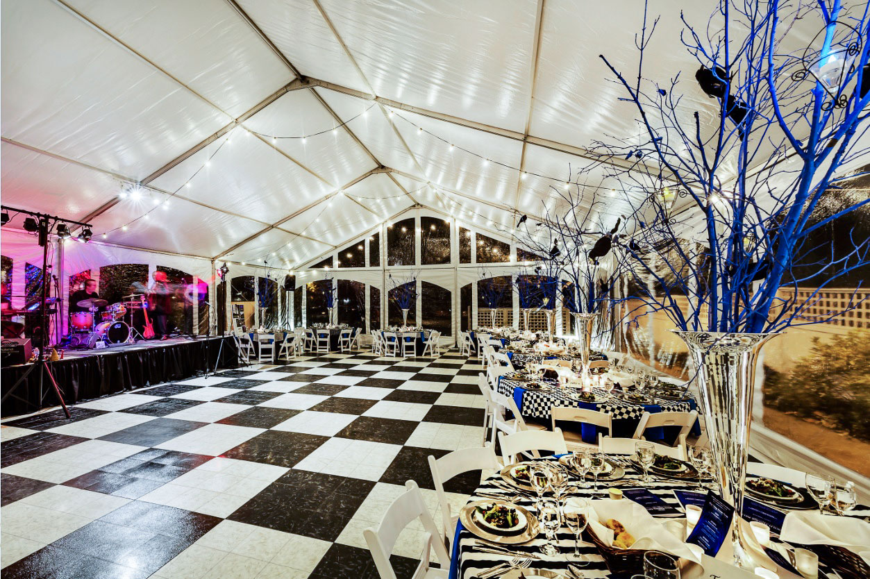 Luxury Black Marble and Luxury White Marble dance floor in a tent interior at night