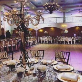 Another view of the indoor wedding space with maple-style SnapLock Dance Floor.