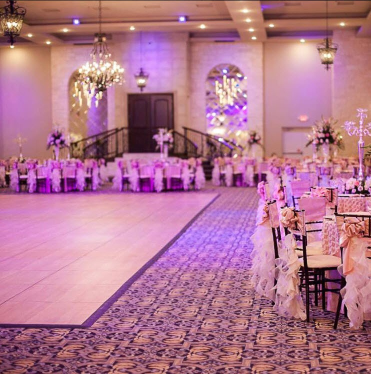 This maple style dance floor reflects the lighting and colors in this wedding space.