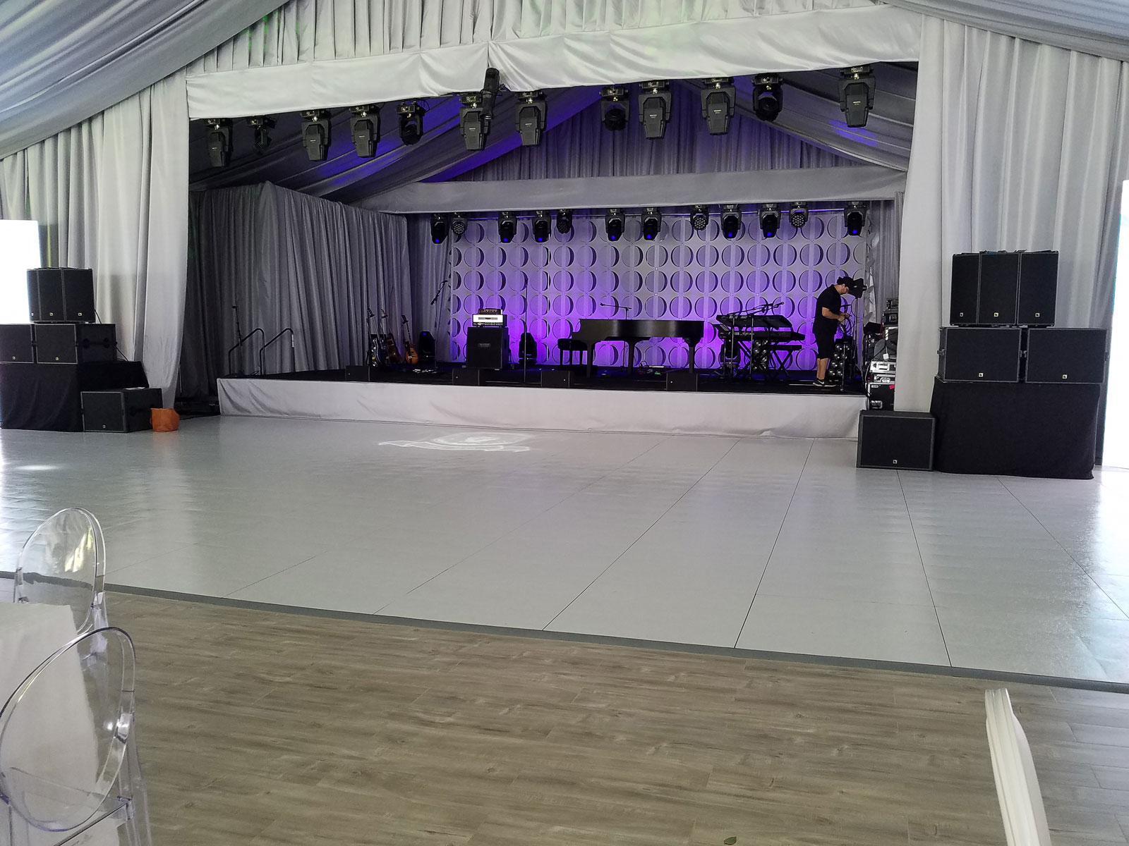 This slate white style dance floor is ready for some music.